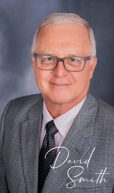 Portrait Photo of White Senior Man Wearing a Suit with a Tie representing David Smith from Sand Oak Divorce Financial Planning Services